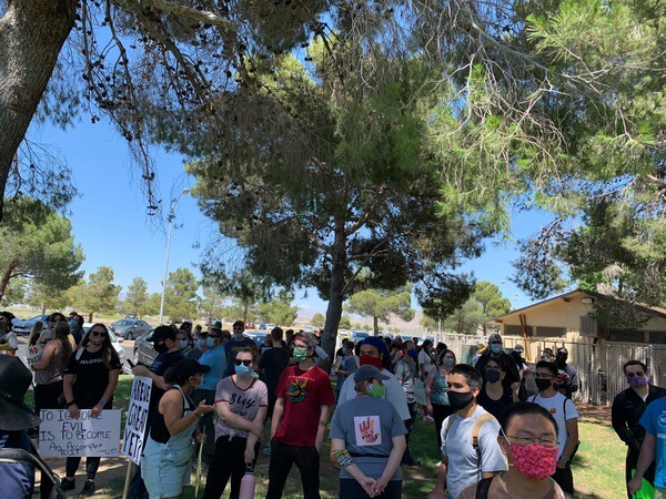 Marchers gather at LeRoy Jackson Park before the June 6 walk.
