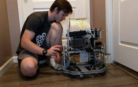 Senior Sam Quick working on the Varsity team robot from home.