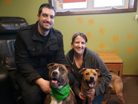 New Chemistry Teacher Jeff West smiles with his two dogs and wife.