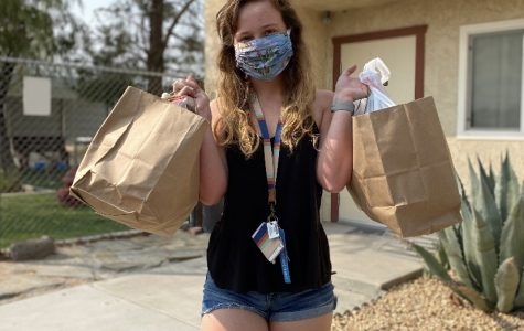 President Megan Small drops off homemade toys for the local animal shelter.