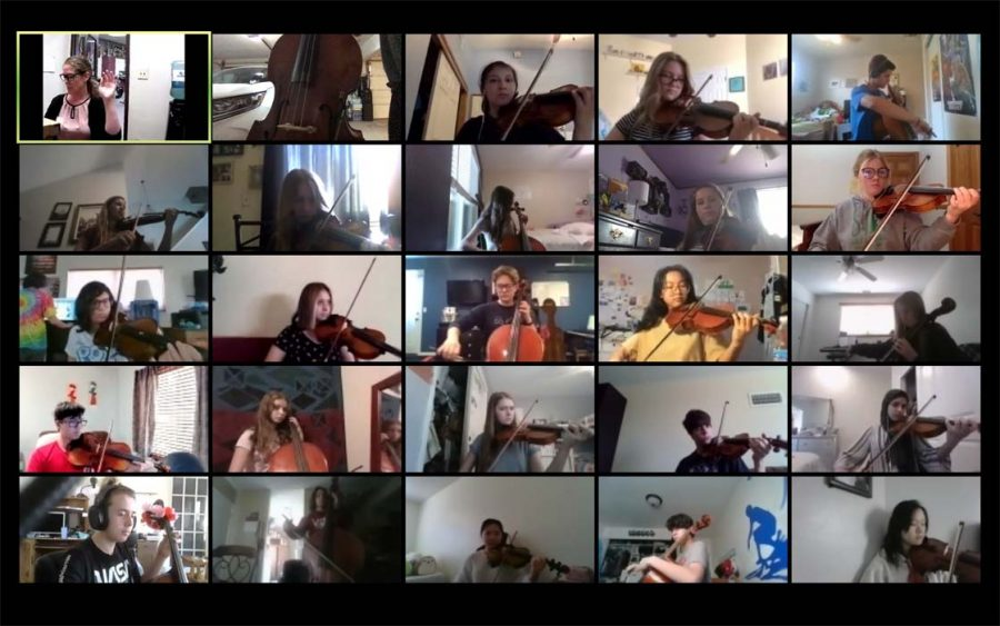 Orchestra students practice during a Zoom call.