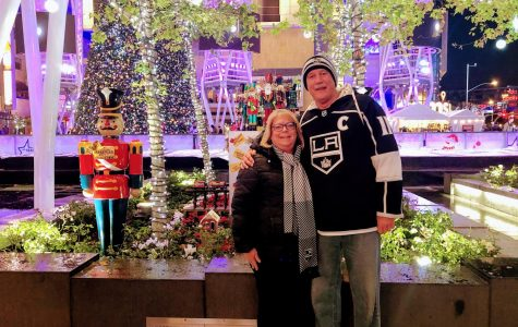 Returning PE Teacher Robert Campbell enjoys a Kings game with his wife.