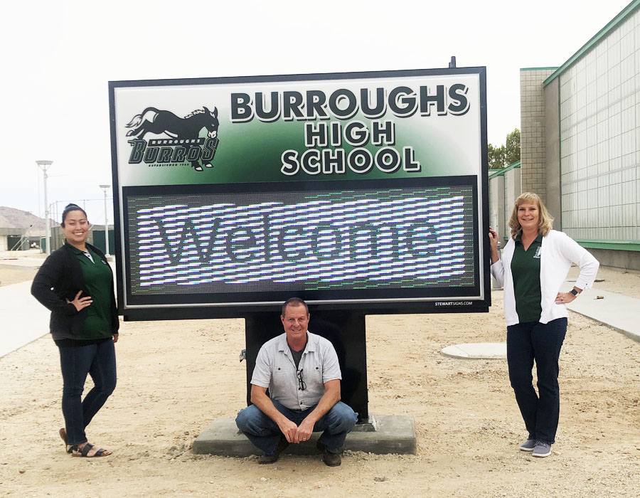 Assistant Principals (from left) Sandra Castro and Chris Ostermann join Principal Carrie Cope in welcoming visitors from the new marquee.