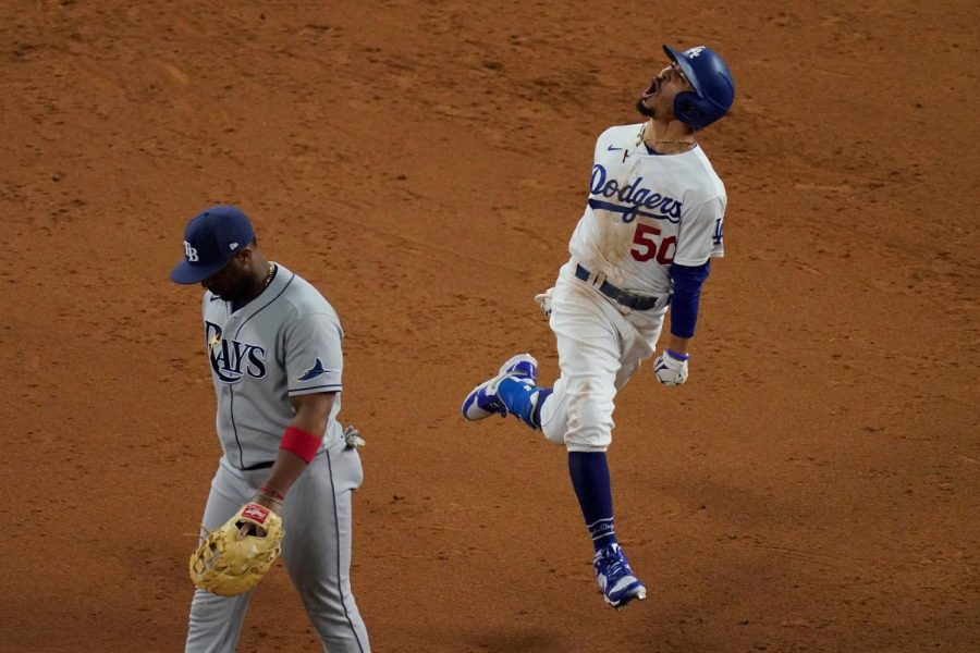 Dodgers player Betts is screaming with emotions after scoring the third run of the World Series final game.