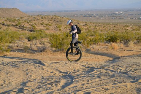 Cayden Houck rides on the trails with his special Hatchet mountain unicycle.