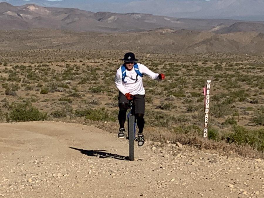 Chad Houck works hard on a mountain unicycle ride.