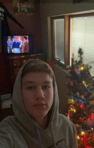 Freshman Tyler Henden likes to watch TV show FRIENDS next to his Christmas tree