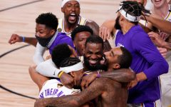 Los Angeles Lakers' LeBron James (23) celebrates with his teammates after the Lakers defeated the Miami Heat 106-93 in Game 6 of basketball's NBA Finals Sunday, Oct. 11, 2020, in Lake Buena Vista, Fla.