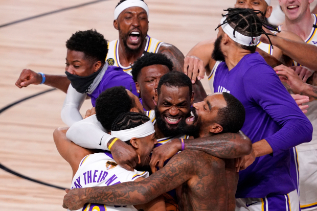 Los+Angeles+Lakers%27+LeBron+James+%2823%29+celebrates+with+his+teammates+after+the+Lakers+defeated+the+Miami+Heat+106-93+in+Game+6+of+basketball%27s+NBA+Finals+Sunday%2C+Oct.+11%2C+2020%2C+in+Lake+Buena+Vista%2C+Fla.+