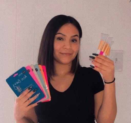Sophomore Sandra Guerrero-Castro shows the products she sells for GlitzandGlow.