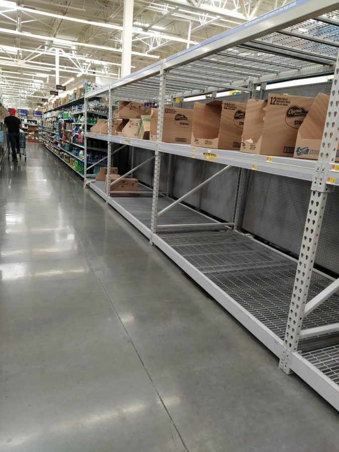 Walmart aisles are quickly being emptied of toilet paper yet again, as talk of a second shutdown spreads.