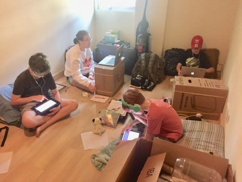Burroughs freshman Sophia Pendergast (second from left) and her brothers finished out their Singapore school year in their makeshift virtual learning headquarters as their house was packed up for the big move.