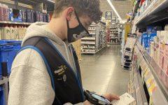 Matt Benson scans an item at his job.