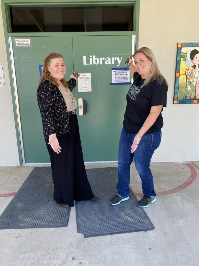Burroughs Librarian Erin Austin and Library Clerk Janna Pearce are ready to  welcome students to the school library.
