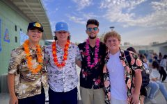 (From left) Seniors Robby Lusher, Conner Batzer, and Michael Farris join Junior Devon Segovia in dressing up for Aloha Day.