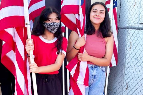 AVID juniors Azalia Hernandez and  Nathaly Flores join other students before the parade.