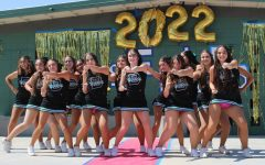 The Burroughs varsity cheerleaders rock the red carpet during the lunchtime fall sports rally.