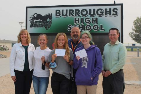 Principal Carrie Cope and Counselors Dave Vigneault and John Hill congratulate (from left) Madison Johnson, Megan Small and Isabel Kidner.