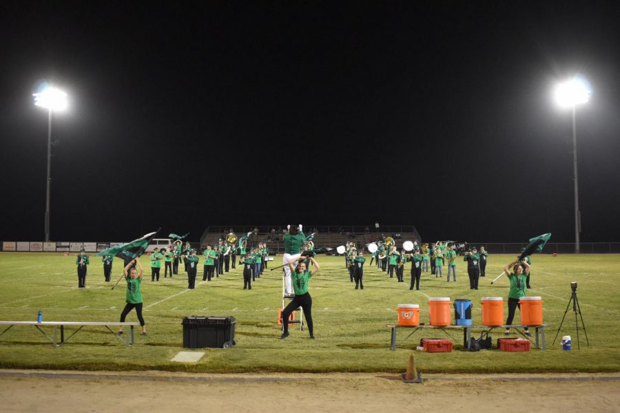 Color+Guard+flawlessly+performs+with+the+band+at+the+Aug.+27+home+football+game.